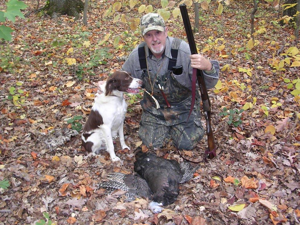 old Virginia turkey hunter and his dog with a wingbone call