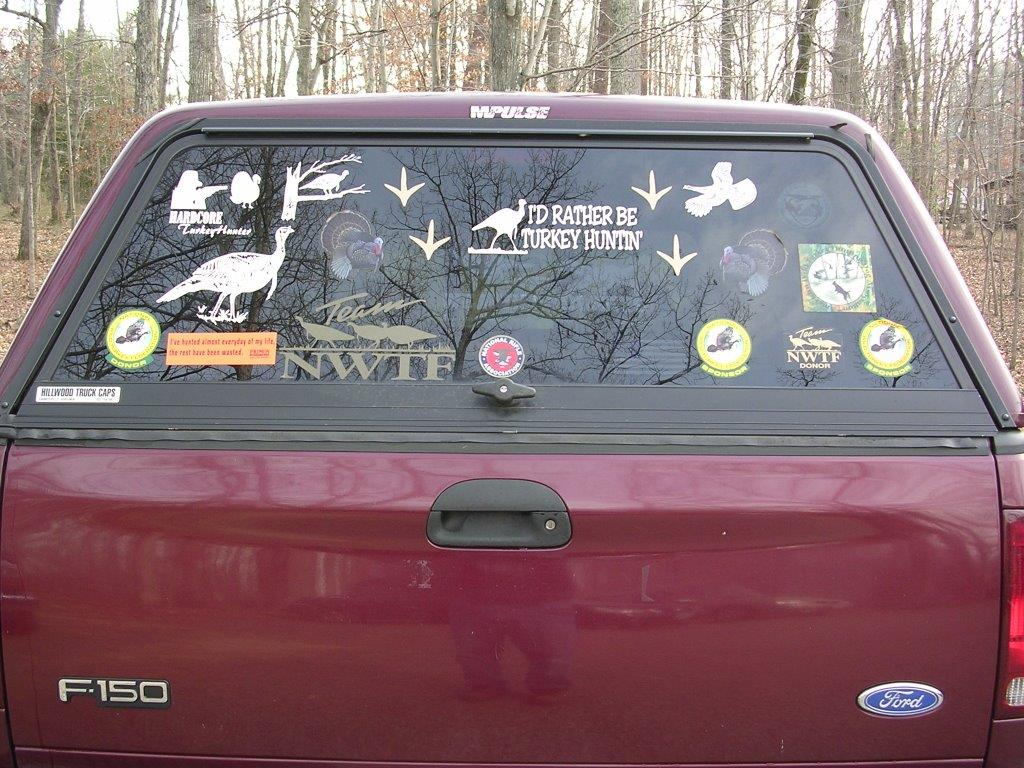 a few decals on the back of a truck