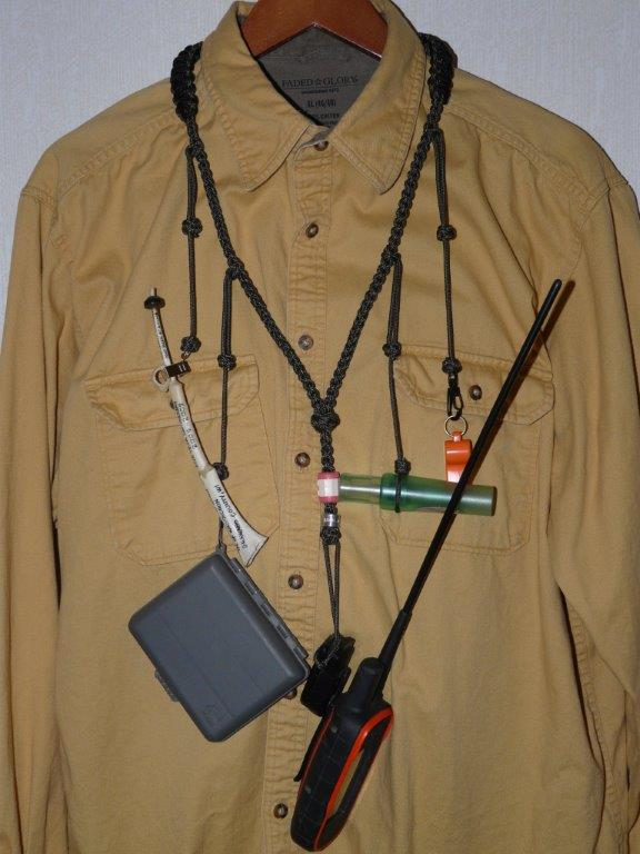 Lanyard holds calls, GPS, whistle, counter, for calling turkeys and monitoring dogs, from FlushDog.Com