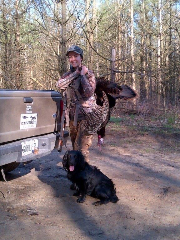 a girl and her dog with a spring                   wild turkey